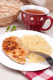 Breaded chicken cutlets with couscous Royalty Free Stock Photography