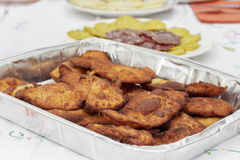 Breaded chicken fillets in aluminium tray Royalty Free Stock Photos