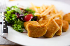 Breaded chicken with french fries Royalty Free Stock Image