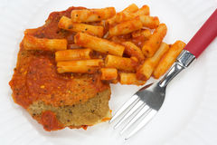 Breaded chicken with pasta and tomato sauce Royalty Free Stock Image