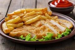 Breaded chicken schnitzel Stock Photos