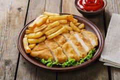 Breaded chicken schnitzel Stock Images