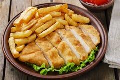 Breaded chicken schnitzel Stock Photography