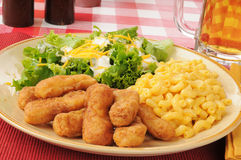 Breaded chicken strips with macaroni and cheese Stock Photo