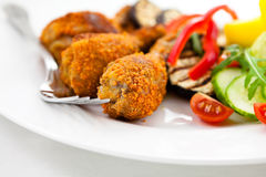 Breaded chicken with vegetables Stock Photos