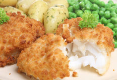 Breaded Cod Fillet and New Potatoes stock photos