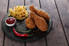 Breaded crispy chicken leg fried french fries  sauce Stock Photos