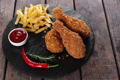 Breaded crispy chicken leg fried french fries  sauce Royalty Free Stock Photos