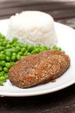 Breaded cutlet with rice and green salad Stock Photography