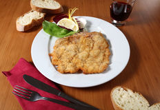 Breaded cutlet and vegetables Stock Images