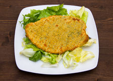 Breaded cutlet on wood Royalty Free Stock Photography