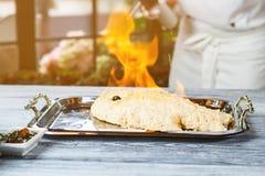 Breaded fish burning on tray. Royalty Free Stock Photo