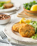 Breaded Fish Cakes. Delicious home made breaded fish cakes with baked beans Stock Image