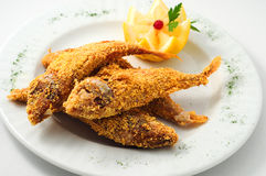 The breaded fish in corn with lemon Royalty Free Stock Photo