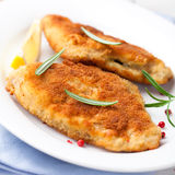 Breaded fish fillet with rosemary and lemon Royalty Free Stock Photography