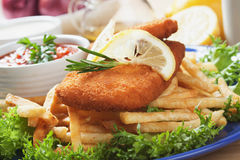 Breaded fish and french fries Stock Photos