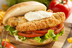 Breaded Fish Sandwich with Tartar Sauce. And Fries stock image