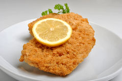 Breaded fish steak Royalty Free Stock Images
