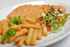 Breaded fish steak with chips Royalty Free Stock Image