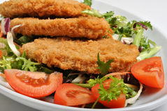 Breaded fish steak with herbs Stock Photo