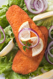 Breaded fish steaks with lemon and lettuce Royalty Free Stock Photos