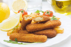 Breaded fish sticks with french fries Royalty Free Stock Photography