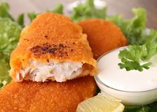 Breaded fish and vegetables Royalty Free Stock Image