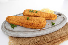 Breaded fish. On a white background royalty free stock photography
