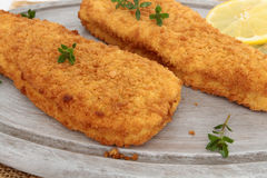 Breaded fish. On a white background stock image