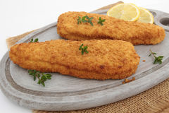 Breaded fish. On a white background stock images