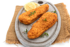 Breaded fish. On a white background royalty free stock photo