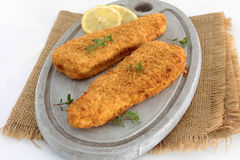 Breaded fish. On a white background royalty free stock images