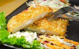 Breaded fried fish steak Royalty Free Stock Photo