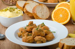 Breaded fried mushrooms with juice Stock Photo