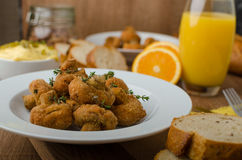 Breaded fried mushrooms with juice Stock Photos