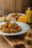 Breaded fried mushrooms with juice Stock Images