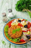 Breaded fried pork cutlet served with pasta salad Royalty Free Stock Image