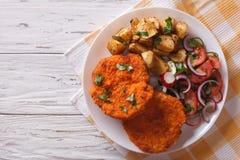 Breaded German Weiner schnitzel with potatoes. horizontal top vi stock photo