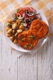 Breaded German Weiner schnitzel with potatoes. vertical top view Stock Images