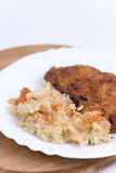 Breaded meat with cooked rice with vegetables Stock Photo