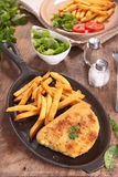 Breaded meat and french fries Royalty Free Stock Photography