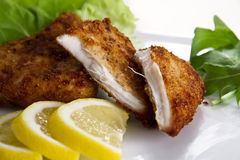 Breaded meat with lemon Royalty Free Stock Image