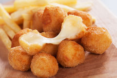 Breaded mozzarella cheese. Balls with french fries Royalty Free Stock Photos
