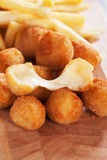 Breaded mozzarella cheese. Balls with french fries Stock Image