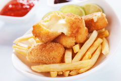 Breaded mozzarella cheese sticks. With french fries Royalty Free Stock Photos