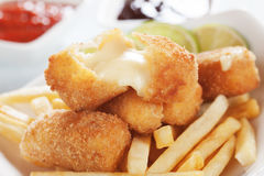 Breaded mozzarella cheese sticks stock images