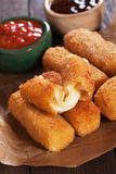 Breaded mozzarellla cheese sticks. Breaded mozzarella cheese sticks with ketchup and bbq sauce Stock Photography
