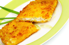 Breaded Сod Fillet. With Spring Onion on Green Plate closeup Stock Image