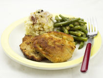 Breaded pork chop with beans Royalty Free Stock Images
