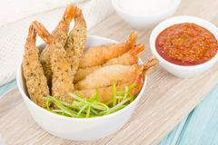 Breaded Prawns. King prawns coated in plain and spicy breadcrumbs and deep-fried Royalty Free Stock Photos